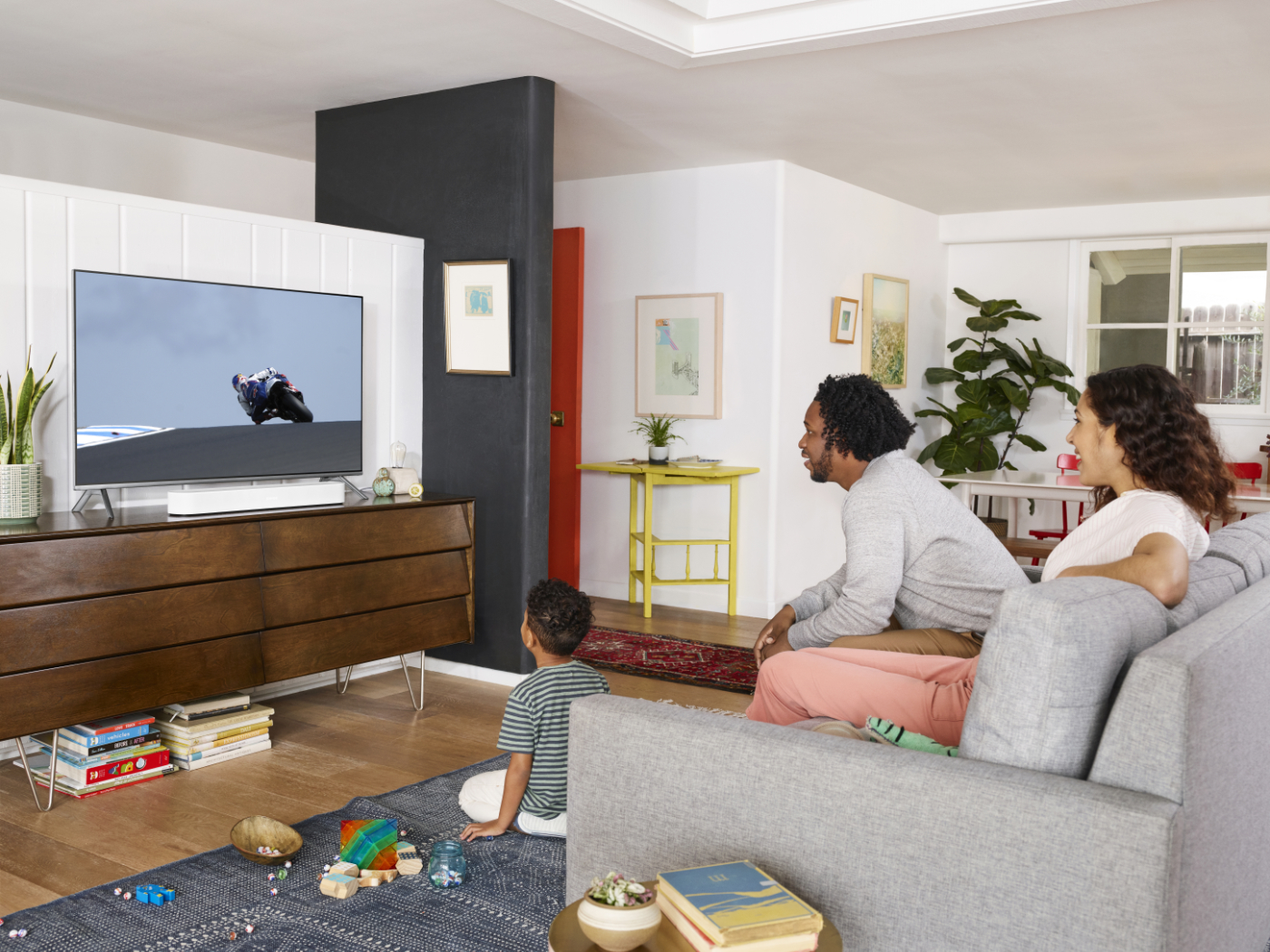 Beam_White-Lifestyle-At_Home_With_Sonos-Large_Living_Room-MotoGp-Q1FY21_MST-MST_JPEG_fid118974